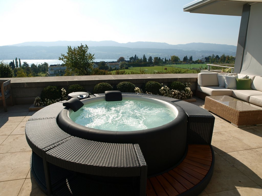 Softub hot tub with rattan surround